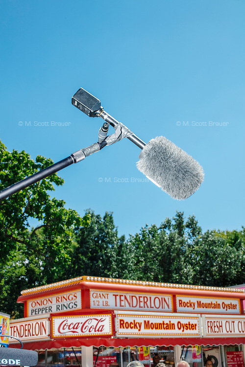A boom mic is seen above the fray as South Bend mayor and Democratic presidential candidate Pete Buttigieg greets people as he walks through the Iowa State Fair in Des Moines, Iowa, on Tues., Aug. 13, 2019.