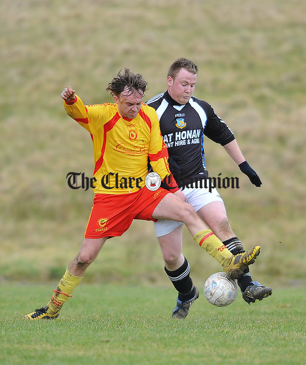 Richie O Grady of Avenue United in action against Damian Honan of West Clare United during their junior cup game at Kilrush. Photograph by John Kelly
