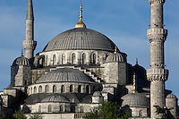 Detail of cascading domes and minarets, Sultan Ahmed Mosque, or Blue Mosque, 1609-16, by Mehmet Aga,  Istanbul, Turkey. The Sultan Ahmed Mosque, commissioned by Sultan Ahmed I, dominates the Istanbul skyline with its cascading domes and six minarets. Built near the Hagia Sophia, it combines Byzantine style with Islamic architecture. The historical areas of the city were declared a UNESCO World Heritage Site in 1985. Picture by Manuel Cohen.