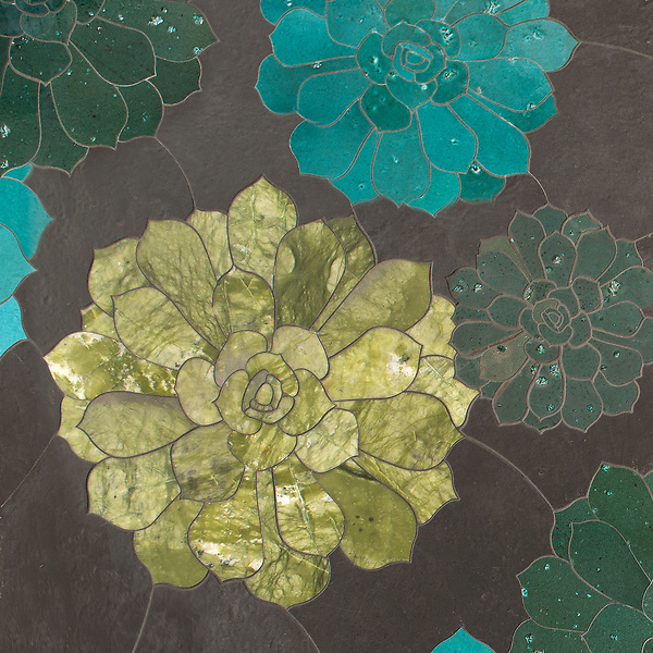 Zita, a waterjet stone mosaic, shown in honed Orpheus Black, honed & polished Ivy Basalto, honed Chartreuse, and polished Aloe Basalto, is part of the Bright Young Things™ collection by New Ravenna.