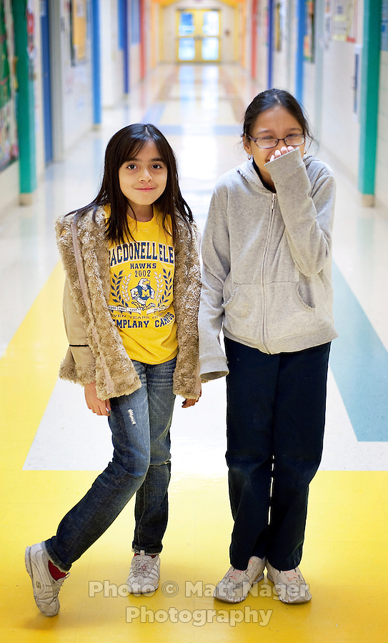 Daniela Gutierrez (cq, left) and Alexandra Lopez (cq), both fourth grade students at C. M. Macdonell Elementary School in Laredo, Texas, who wrote letters to the D. Dalton book store sompany asking to not have their bookstore, the only bookstore in town, close. With over 95 percent of the population as Hispanic Spanish speakers, Laredo ranked the lowest in literacy rates in the 2000 US census. Today there are a number of bi-lingual and dual langauge classes set up to help students and adults learn english...PHOTOS/ MATT NAGER