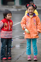 Young girls in the playground of a primary school in Fuli. China has a one child policy to limit population.