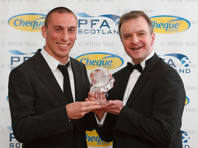 Scott Brown is presented with the PFA Scotland Player of the Year award from Fraser Wishart