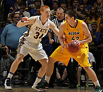 SIOUX FALLS, SD - MARCH 12:  Marshall Bjorklund #42 of North Dakota State dribbles into pressure from Tony Fiegen #34 of South Dakota State during their championship game at the 2013 Summit League Tournament at the Sioux Falls Arena. (Photo by Dick Carlson/Inertia)