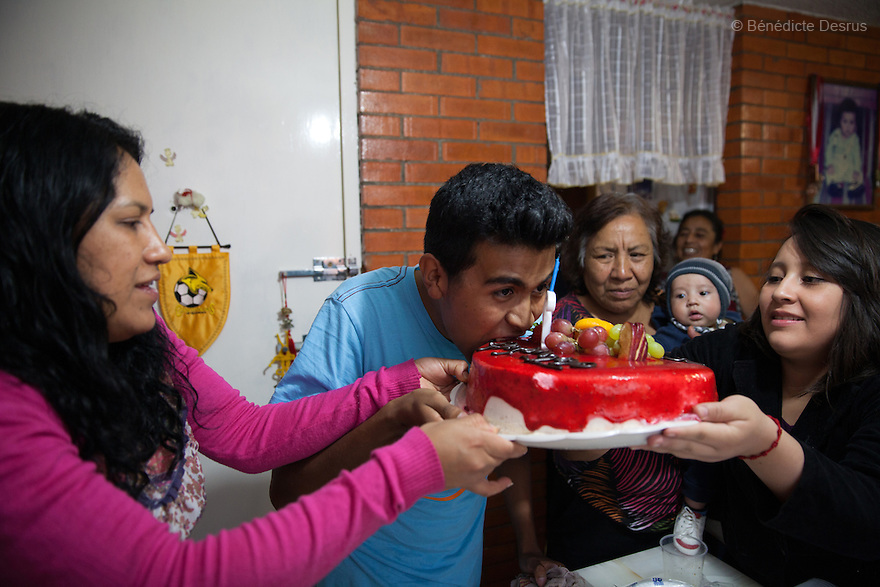 "Baruch and his family on his eighteenth birthday at his home in the Iztapalapa area of Mexico City, Mexico on July 17, 2014. Baruch Alejandro Anleu Ramirez, 18, is the captain of Guerreros Aztecas. Two years ago, Baruch had his left leg amputated due to bone cancer. He used to practice as much as his chemotherapy would allow. Expelled from school for missing too many classes during his treatment, he says, ""Guerreros Aztecas has filled a big hole in my life"". Baruch was Guerreros Aztecas's brightest hope to represent Mexico at the Amputee Soccer World Cup. But since the cancer's spread to his lungs, he can no longer play or train with the team. Guerreros Aztecas (""Aztec Warriors"") is Mexico City's first amputee football team. Founded in July 2013 by five volunteers, they now have 23 players, seven of them have made the national team's shortlist to represent Mexico at this year's Amputee Soccer World Cup in Sinaloa this December. The team trains twice a week for weekend games with other teams. No prostheses are used, so field players missing a lower extremity can only play using crutches. Those missing an upper extremity play as goalkeepers. The teams play six per side with unlimited substitutions. Each half lasts 25 minutes. The causes of the amputations range from accidents to medical interventions – none of which have stopped the Guerreros Aztecas from continuing to play. The players' age, backgrounds and professions cover the full sweep of Mexican society, and they are united by the will to keep their heads held high in a country where discrimination against the disabled remains widespread. (Photo by Bénédicte Desrus)"