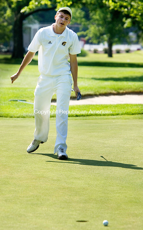 DANBURY CT. 31 May 2013-053113SV05-Joe Klokus, 17, of Weston High watches as his ball just misses the cup on the 9th green during the South West Conference golf championship at Ridgewood Country Club in Danbury Friday.<br /> Steven Valenti Republican-American