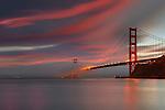 Fog over the Golden Gate Bridge at sunset, San Francisco, California, USA.