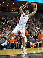 Virginia center Mike Tobey (10) grabs a rebound in front of Clemson center Landry Nnoko (35) during an ACC basketball game Tuesday Jan. 19, 2016, in Charlottesville, Va. (Photo/Andrew Shurtleff)