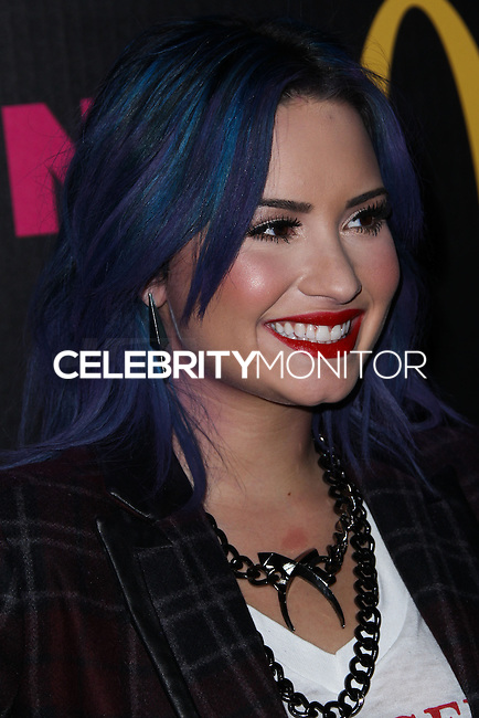 WEST HOLLYWOOD, CA - DECEMBER 05: Singer Demi Lovato arrives at the Nylon Magazine December 2013/January 2014 Cover Launch Party held at Quixote Studios on December 5, 2013 in West Hollywood, California. (Photo by Xavier Collin/Celebrity Monitor)