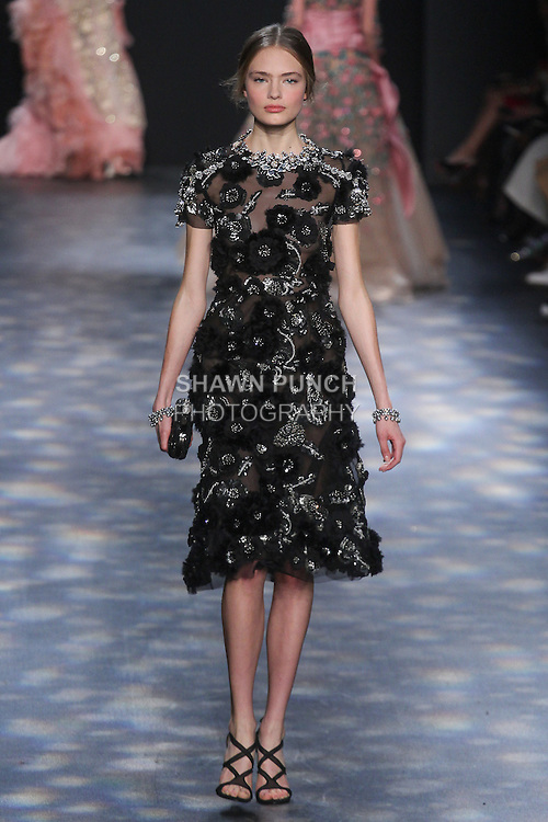 Model Anna walks runway in a black tulle cocktail with gunmetal and jet 3D feather flower embroidery, from the Marchesa Fall 2016 collection by Georgina Chapman and Keren Craig, presented at NYFW: The Shows Fall 2016, during New York Fashion Week Fall 2016.