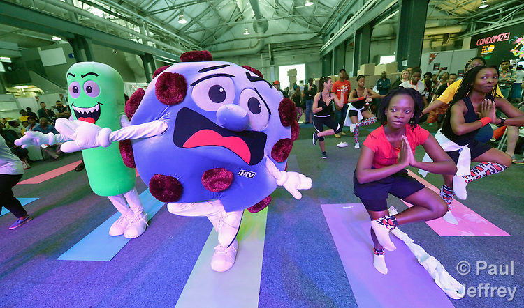 Mascots representing TB and HIV, which are often fatal when they get together, join in an aerobics session in the Global Village at the 2016 International AIDS Conference in Durban.