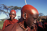 Toronkei, a Maasai moran has  had his head shaved by his mother as part of his initiation into manhood.<br /> Kajiado, Kenya.