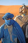 Taureg camel herder and camels Merzouga, Sahara desert, Morocco, north Africa