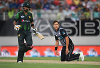Babar Azam takes a run as Trent Boult looks on.<br /> Pakistan tour of New Zealand. T20 Series.2nd Twenty20 international cricket match, Eden Park, Auckland, New Zealand. Thursday 25 January 2018. &copy; Copyright Photo: Andrew Cornaga / www.Photosport.nz