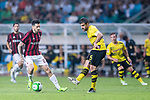 Borussia Dortmund Defender Sokratis Papastathopoulos (R) in action against AC Milan Midfielder Jose Sosa (L) during the International Champions Cup 2017 match between AC Milan vs Borussia Dortmund at University Town Sports Centre Stadium on July 18, 2017 in Guangzhou, China. Photo by Marcio Rodrigo Machado / Power Sport Images