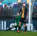 Berwick's Michael Dunlop is distraught after he heads the ball into his own net for Culter's equaliser.