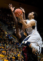Justin Cobbs of California shoots the ball during the game against USC at Haas Pavilion in Berkeley, California on February 17th, 2013.  California defeated USC, 76-68.