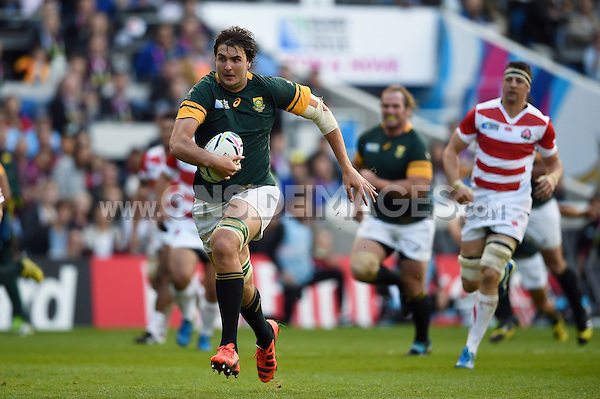 Lodewyk De Jager of South Africa runs in a try. Rugby World Cup Pool B match between South Africa and Japan on September 19, 2015 at the Brighton Community Stadium in Brighton, England. Photo by: Patrick Khachfe / Onside Images