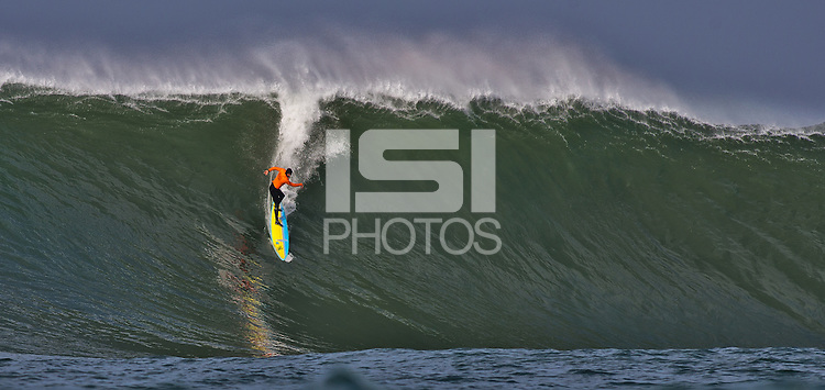 Half Moon Bay, California - January 24, 2014: 2014 Maverick's Invitational Kohl Christensen  making the drop.