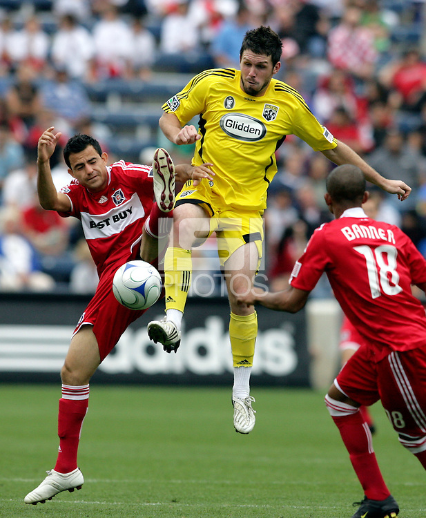 Columbus Crew midfielder Danny O'Rourke (5) outjumps Chicago Fire midfielder Marco Pappa (16) for the ball.  The Columbus Crew tied the Chicago Fire 2-2 at Toyota Park in Bridgeview, IL on September 20, 2009.