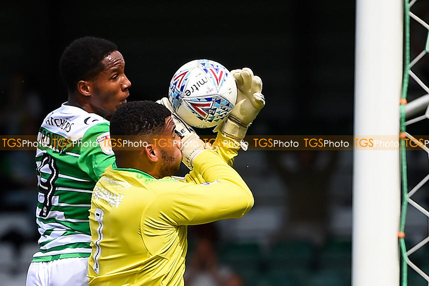 Rhys Browne of Yeovil Town challenges Accrington Stanley keeper Aaron Chapman during Yeovil Town vs Accrington Stanley, Sky Bet EFL League 2 Football at Huish Park on 12th August 2017