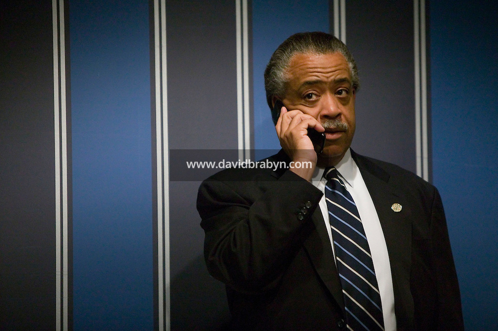 21 April 2007 - New York City, NY - The Reverend Al Sharpton makes a call on his cell phone during the 9th Annual National Action Network Convention in New York City, USA, 21 April 2007.