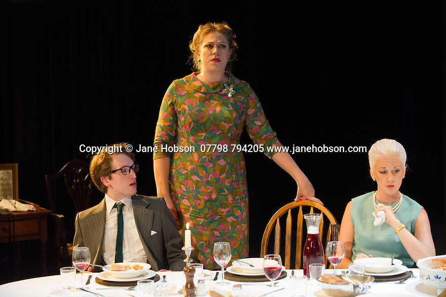 London, UK. 18.07.2014. Mountview Academy of Theatre Arts presents SATURDAY, SUNDAY, MONDAY by Eduardo de Filippo, the English adaptation by Keith Waterhouse & Willis Hall, directed by Michael Howcroft, at the Unicorn Theatre, as part of the Postgraduate Season 2014. Picture shows:  James Ruskin (Dr Cefercola), Sophie Napleton (Aunt Meme) and Alexandria Bull (Elena Ianniello). Photograph © Jane Hobson.