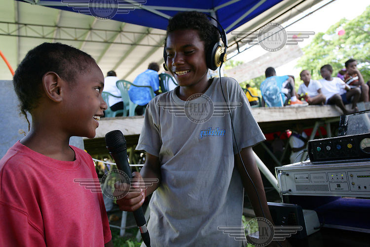 A boy being interviewed at festivities for International Children's Day in Honiara. UNICEF is a partner and supporter of this event.