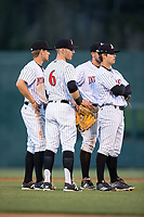 The Kannapolis Intimidators infield (Max Dutto (6), Zach Remillard (8), Mitch Roman (10), and Brandon Dulin (31)) huddle up as a new pitcher warms up during the game against the Lakewood BlueClaws at Kannapolis Intimidators Stadium on April 9, 2017 in Kannapolis, North Carolina.  The BlueClaws defeated the Intimidators 7-1.  (Brian Westerholt/Four Seam Images)