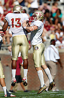 TALLAHASSEE, FLA. 4/16/11-FSUG&G041611 CH-Kicker Dustin Hopkins, right, celebrates with Nigel Bradham after he connected for a 60 yard field goal during first half action in the Florida State University Garnet and Gold game Saturday in Tallahassee..COLIN HACKLEY PHOTO