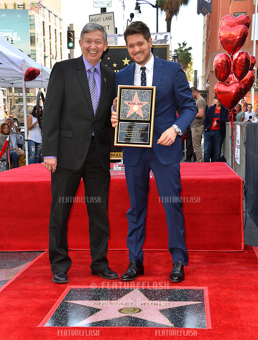 LOS ANGELES, CA. November 16, 2018: Michael Buble &amp; Leron Gubler at the Hollywood Walk of Fame Star Ceremony honoring singer Michael Bubl&eacute;.<br /> Pictures: Paul Smith/Featureflash