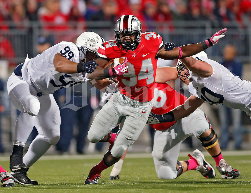Ohio State Buckeyes running back Carlos Hyde (34) splits Penn State Nittany Lions defensive tackle Austin Johnson (99) and Penn State Nittany Lions linebacker Glenn Carson (40) in the 3rd quarter at Ohio Stadium on October 26, 2013.  (Dispatch photo by Kyle Robertson)