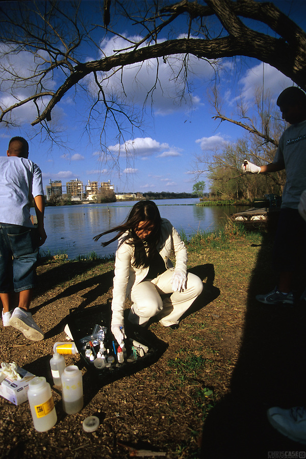 Jessica Martinez, a member of the Austin Youth River Watch program, checks for pH levels and nutrient content on Waller Creek, a tributary of the Colorado River. The program was begun in the early 1990s to give at-risk youth an opportunity to remove themselves from negative environments while learning about the river and the scientific processes of ecosystems.