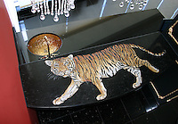 Custom Tiger bar top in Nero Marquina, Giallo Reale, Renaissance Bronze, Rosa Verona,Botticino, Crema Marfil honed and pillowed
