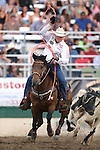 Clay O'Brien Cooper competes in the team roping event at the Reno Rodeo in Reno, Nev. on Friday, June 19, 2015.<br /> Photo by Cathleen Allison/Nevada Photo Source