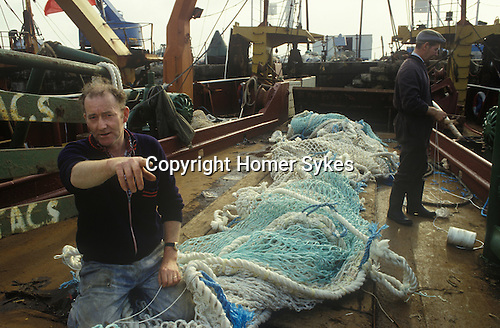 Fishing industry mending nets Fleetwood Lancashire  1980s