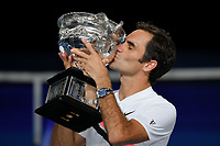 January 28, 2018: Number two seed Roger Federer of Switzerland poses for photographs with the trophy after winning the Men's Final against number six seed Marin Cilic of Croatia on day fourteen of the 2018 Australian Open Grand Slam tennis tournament in Melbourne, Australia. Federer won 3 sets to 2. Photo Sydney Low