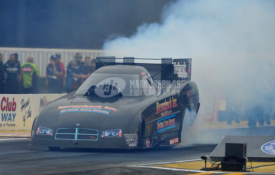Nov. 10, 2011; Pomona, CA, USA; NHRA funny car driver Jon Capps during qualifying at the Auto Club Finals at Auto Club Raceway at Pomona. Mandatory Credit: Mark J. Rebilas-.