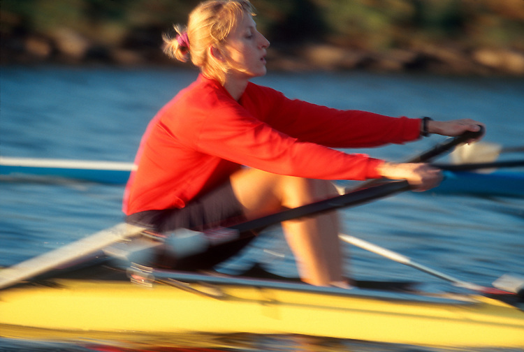 Woman rowing in blur motion, Christine Collins Smith, 1996 silver medal in lightweight women's double, 1996 Olympics.