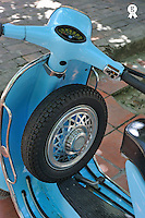 Blue motor scooter with spare tire (Licence this image exclusively with Getty: http://www.gettyimages.com/detail/83154215 )