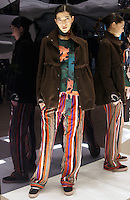 Model in Look 11: Rustic Vine Top, Brown Melton Short Coat, Native Stripe Pants