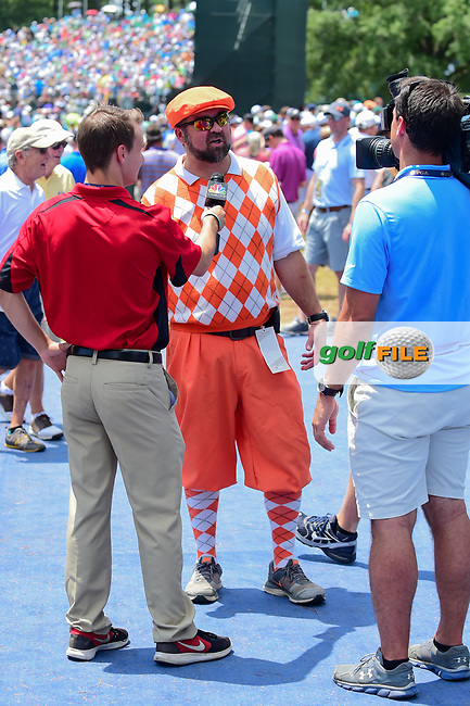 An avid golf fan, dressed in his colors is interviewed at the front gate during Thursday's round 1 of the PGA Championship at the Quail Hollow Club in Charlotte, North Carolina. 8/10/2017.<br /> Picture: Golffile | Ken Murray<br /> <br /> <br /> All photo usage must carry mandatory copyright credit (&copy; Golffile | Ken Murray)