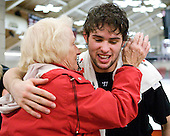 Colin Blackwell (Harvard - 63) gets a hug good night from his grandmother. - The Yale University Bulldogs defeated the Harvard University Crimson 5-1 on Saturday, November 3, 2012, at Bright Hockey Center in Boston, Massachusetts.
