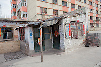 Old apartment with modern apartment building in the background,  Shanxi Province of China
