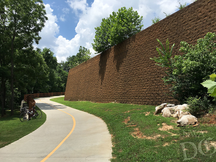 NWA Democrat-Gazette/FLIP PUTTHOFF <br /> The Great Wall of Lowell is a formidable sight along the Razorback Greenway. The retaining wall is south of Arkansas 264.