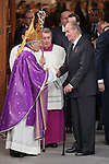 King Juand Carlos of Spain (R) kisses Archbishop of Madrid Rouco Varela (L) in his hand after leaving the state funeral for former Spanish prime minister Adolfo Suarez at the Almudena Cathedral in Madrid, Spain. March 31, 2014. (ALTERPHOTOS/Victor Blanco)