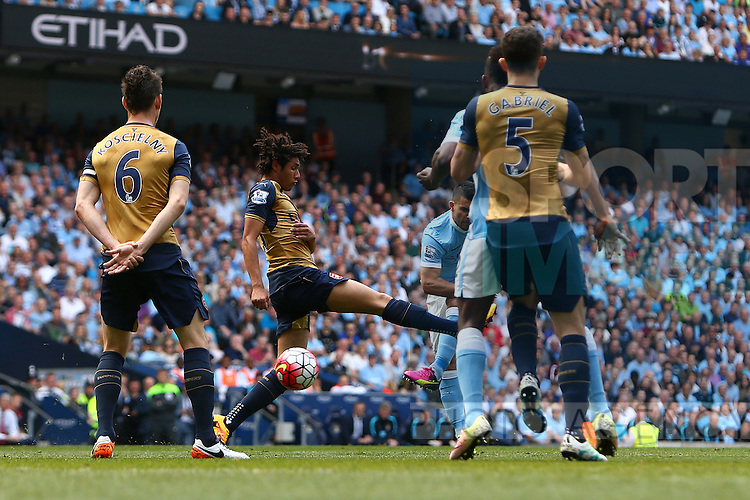 Sergio Aguero of Manchester City scores the opening goal during the Barclays Premier League match at the Etihad Stadium. Photo credit should read: Philip Oldham/Sportimage
