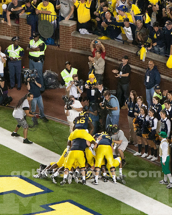 "The University of Michigan football team defeats the University of Notre Dame 35-31 ""Under the lights at the Big House"" at Michigan Stadium in Ann Arbor, Mich., on September 10, 2011."