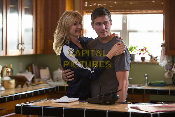 Laura Dern, Jim Caviezel <br /> in When the Game Stands Tall (2014) <br /> *Filmstill - Editorial Use Only*<br /> CAP/FB<br /> Image supplied by Capital Pictures
