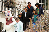 Washington, DC - April 13, 2009 -- United States President Barack Obama (C) walks with the First Family; first lady Michelle (top R), Michelle's mother Marian Robinson (top), daughters Natasha (L) and Malia (R), behind an Easter Bunny being escorted by White House staff  at the Easter Egg Roll, South Lawn of the White House in Washington DC, USA, Monday, 13 April 2009. .Credit: Michael Reynolds - Pool via CNP